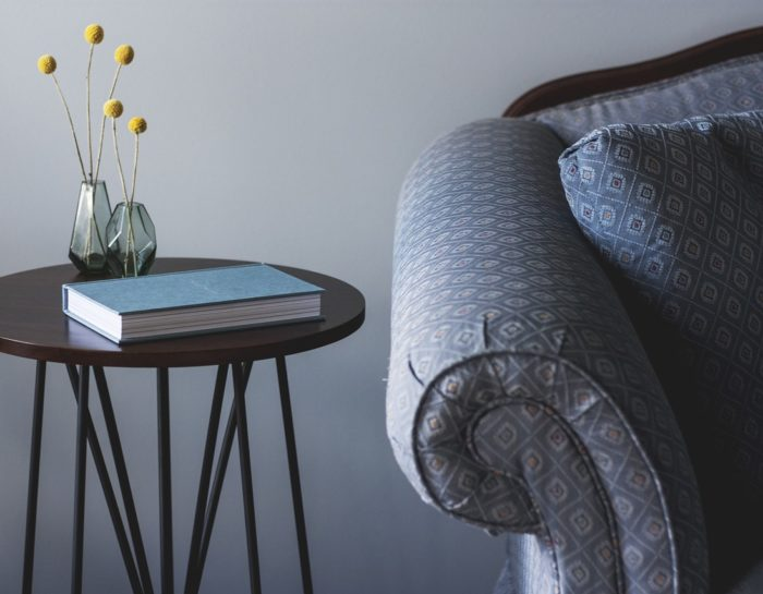Creative Flower Vase Besides Elegant Sofa